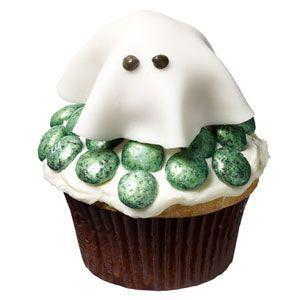 """<p>The trick to making this ethereal apparition floating above your cupcake? A donut hole and some fondant. Easy!</p><p><strong><a href=""""https://www.countryliving.com/food-drinks/recipes/a32711/friendly-ghost-cupcake-recipe-122729/"""" rel=""""nofollow noopener"""" target=""""_blank"""" data-ylk=""""slk:Get the recipe"""" class=""""link rapid-noclick-resp"""">Get the recipe</a>.</strong></p>"""