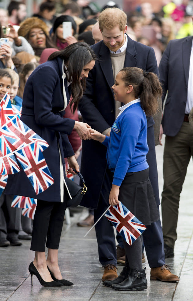 Meghan shakes hands with Sophia Richards, a pupil from the Oasis Academy Warndon in Worcester