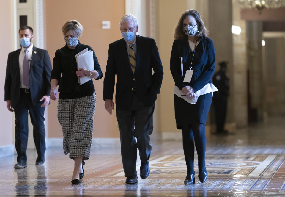 Senate Minority Leader Mitch McConnell, R-Ky., returns to the chamber after the Senate voted to consider hearing from witnesses in the impeachment trial of former President Donald Trump, at the Capitol in Washington, Saturday, Feb. 13, 2021. (AP Photo/J. Scott Applewhite)