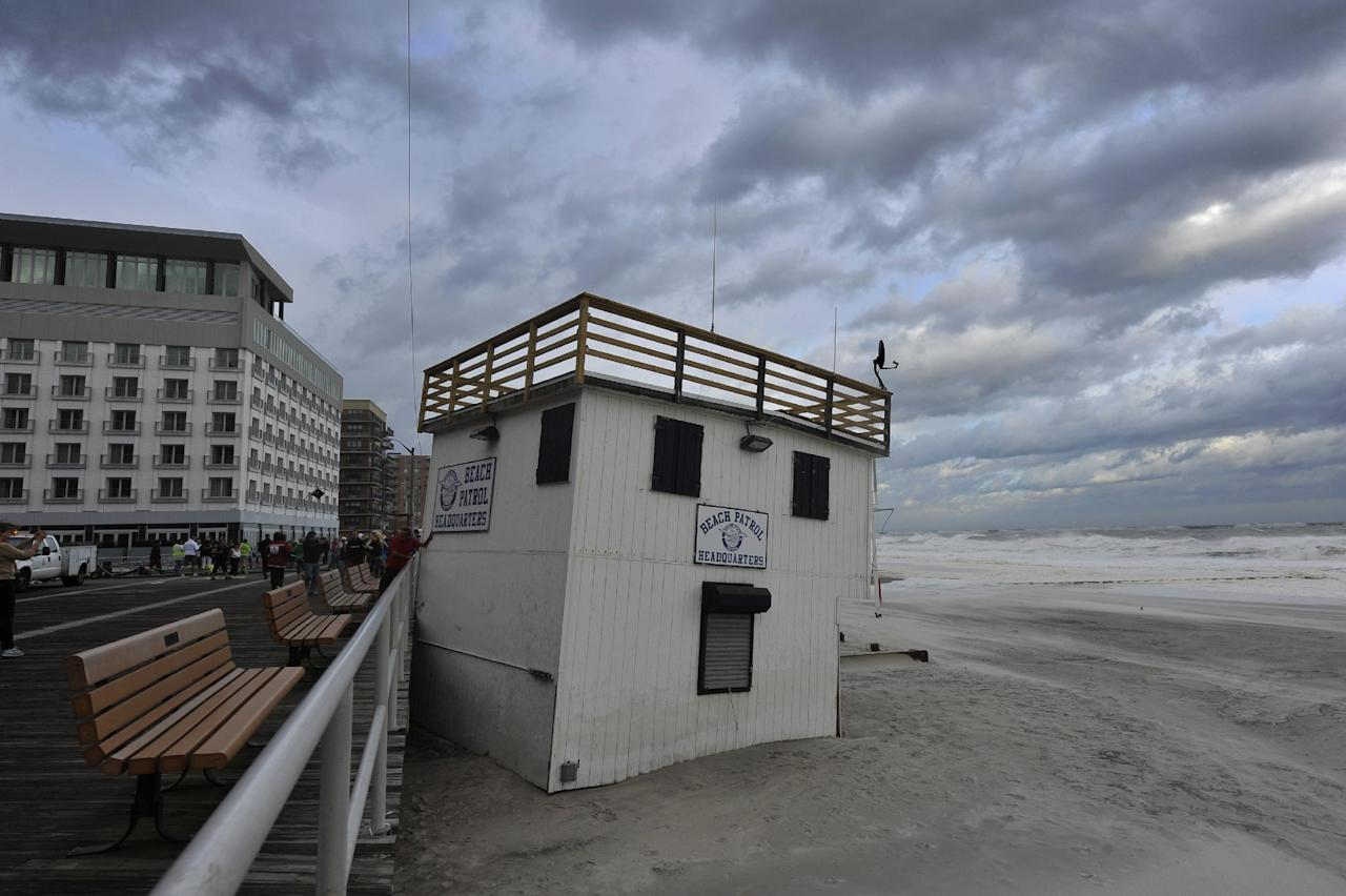 A Beach Patrol Headquarters used by the City of Long Beach lifeguards was lifted and moved to the boardwalk by the strong winds of Tropical Storm Irene as it swept through Long Island on Sunday, Aug. 28, 2011, in Long Beach, N.Y. Stripped of hurricane rank, Tropical Storm Irene spent the last of its fury Sunday, leaving treacherous flooding and millions without power _ but an unfazed New York and relief that it was nothing like the nightmare authorities feared. (AP Photo/Kathy Kmonicek)