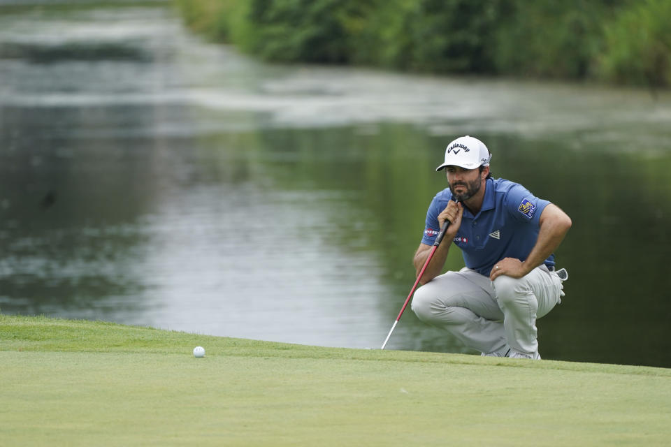 Adam Hadwin lines up a shot on the sixth hole during the second round of the 3M Open golf tournament in Blaine, Minn., Friday, July 23, 2021. (AP Photo/Craig Lassig)