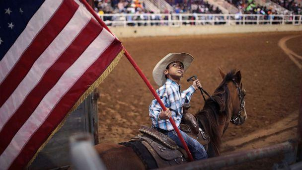 PHOTO: Lindon Demery carries the flag into the arena before the start of competition at the Bill Pickett Invitational Rodeo on March 31, 2017 in Memphis, Tenn. (Scott Olson/Getty Images, FILE)