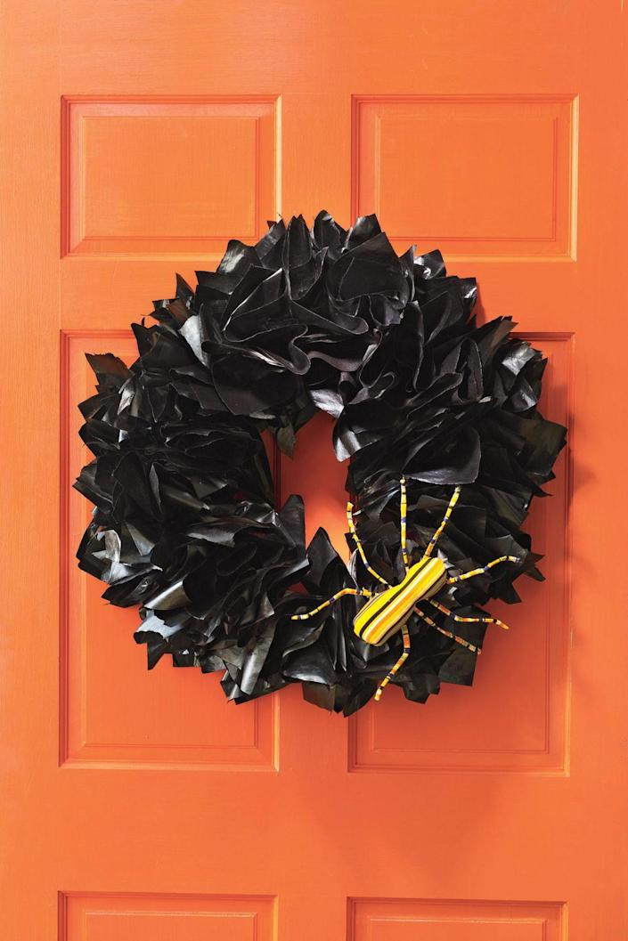 """<p>Trash bags transform into a spooky wreath with the help of a few easy steps. Just bunch strips of bunched bags around a wreath form.</p><p><a class=""""link rapid-noclick-resp"""" href=""""https://www.amazon.com/Royalty-Essentials-Metal-Wreath-Hanger/dp/B07LBVJXXK?tag=syn-yahoo-20&ascsubtag=%5Bartid%7C10070.g.2488%5Bsrc%7Cyahoo-us"""" rel=""""nofollow noopener"""" target=""""_blank"""" data-ylk=""""slk:SHOP WREATH FORM"""">SHOP WREATH FORM</a></p>"""