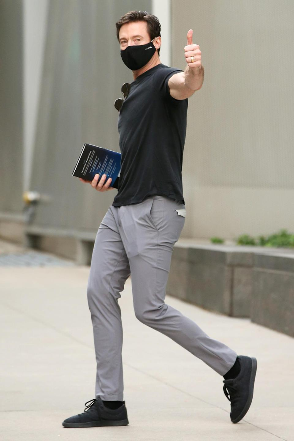 <p>Hugh Jackman flashes a thumbs up while out and about on his birthday on Oct. 12 in N.Y.C. </p>