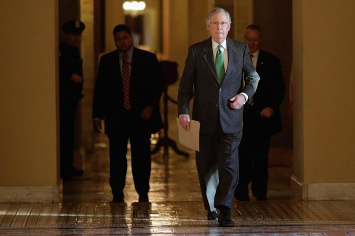 Senate Majority Leader Mitch McConnell walks from his office in the Capitol to the Senate chamber to open debate on a funding bill for the Department of Homeland Security, on February 23, 2015 in Washington, DC (AFP Photo/Chip Somodevilla)