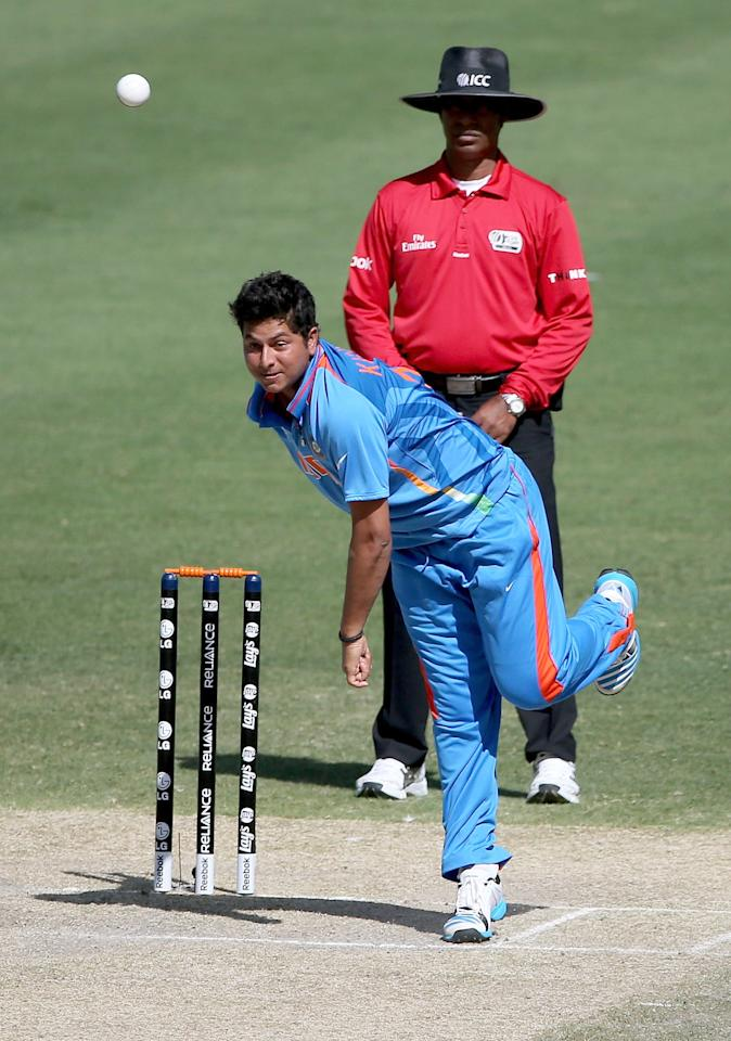 DUBAI, UNITED ARAB EMIRATES - FEBRUARY 17:  Kuldeep Yadav of india bowls during the ICC U19 Cricket World Cup 2014 match between India and Scotland at the Dubai Sports City Cricket Stadium on February 17, 2014 in Dubai, United Arab Emirates.  (Photo by Francois Nel - IDI/IDI via Getty Images)