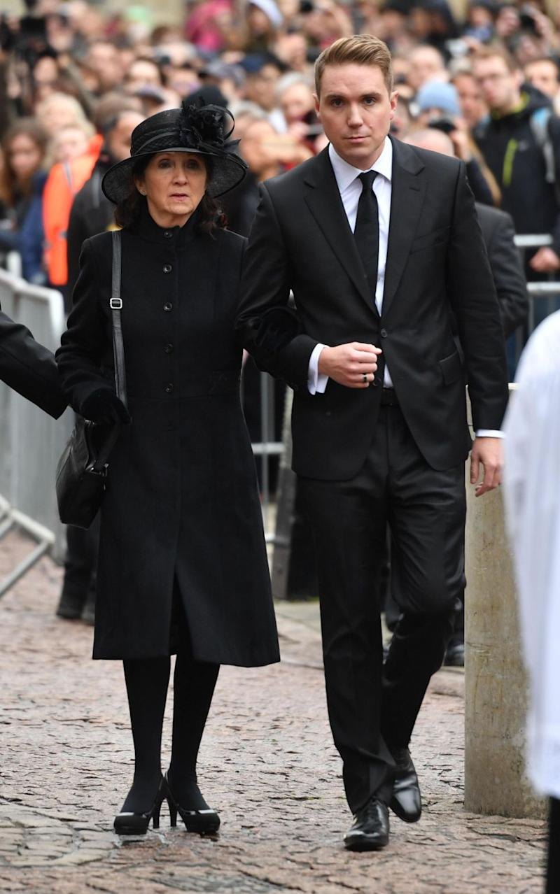 Hawking's first wife Jane arrived on the arm of her son. Photo: AAP