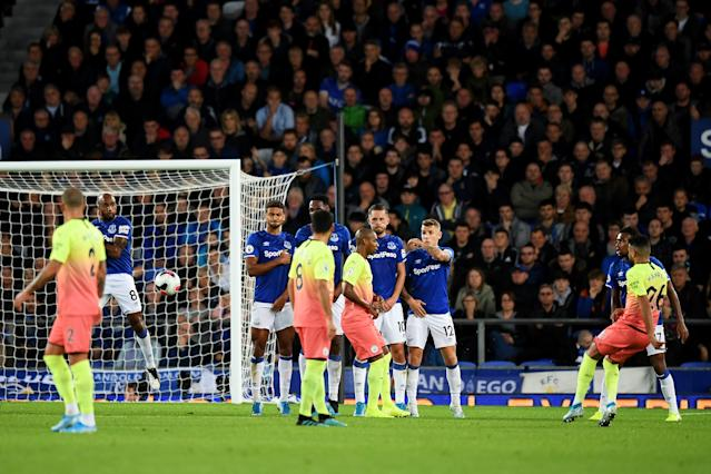 Mahrez curling around the wall and into the bottom corner (Photo by Michael Regan/Getty Images)