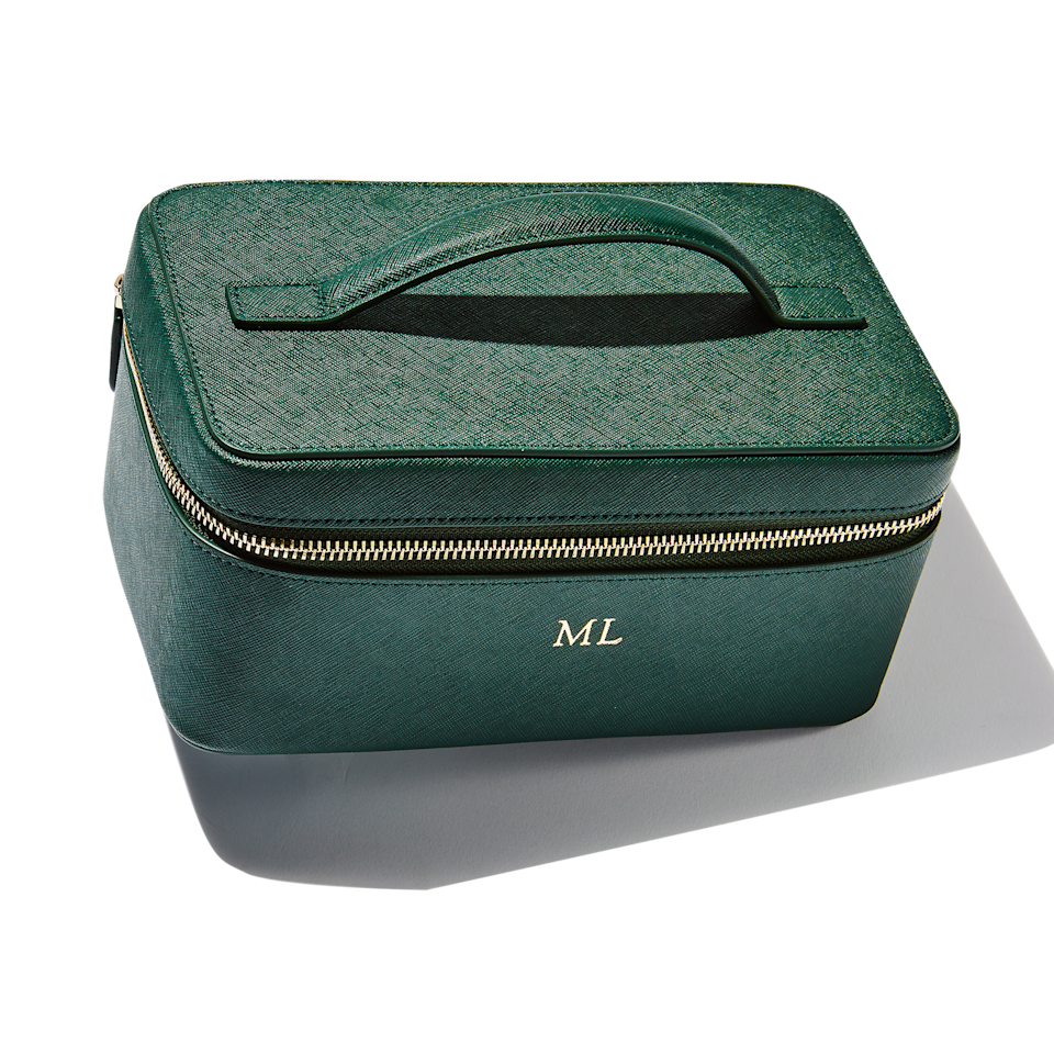 "<p>My everyday products have a special home in this deceptively roomy Forest Green <a href=""https://www.allure.com/story/most-popular-makeup-bags?mbid=synd_yahoo_rss"" rel=""nofollow noopener"" target=""_blank"" data-ylk=""slk:Vanity Case"" class=""link rapid-noclick-resp"">Vanity Case</a> from The Daily Edited. You can also add your initials to this tote, like I did, to show the world that this 100 percent saffiano leather case with gold hardware — and everything inside of it — is all yours. It also comes with two removable pouches, as well as an interior zip pocket and two small side pockets. With <a href=""https://www.thedailyedited.com/catalogsearch/result/?q=vanity+case"" rel=""nofollow noopener"" target=""_blank"" data-ylk=""slk:five additional color options,"" class=""link rapid-noclick-resp"">five additional color options,</a> you can pick the one that speaks to you the most.</p> <p><strong>$140</strong> (<a href=""https://www.thedailyedited.com/forest-green-vanity-case"" rel=""nofollow noopener"" target=""_blank"" data-ylk=""slk:Shop Now"" class=""link rapid-noclick-resp"">Shop Now</a>)</p>"