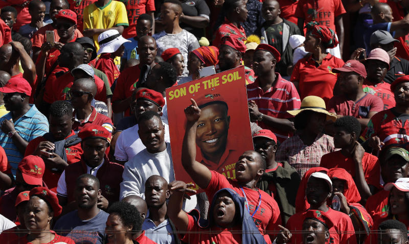 Members of the Economic Freedom Fighters (EFF) party attend a May Day Rally in Alexandra Township, Johannesburg, Wednesday, May 1, 2019. In South Africa, the Economic Freedom Fighters opposition party used the day to rally voters a week before the country's national election. Wearing their signature red shirts and berets, members gathered at a stadium in Johannesburg in cheering support of populist stances that have put pressure on the ruling African National Congress to address issues like economic inequality and land reform. (AP Photo/Themba Hadebe)