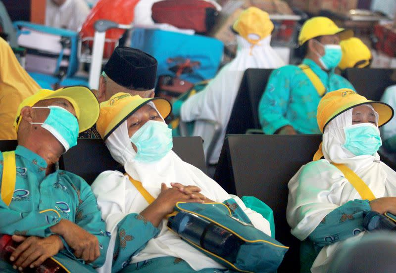 Umrah pilgrims sleep after the cancellation of the departure to Mecca at Soekarno Hatta International Airport