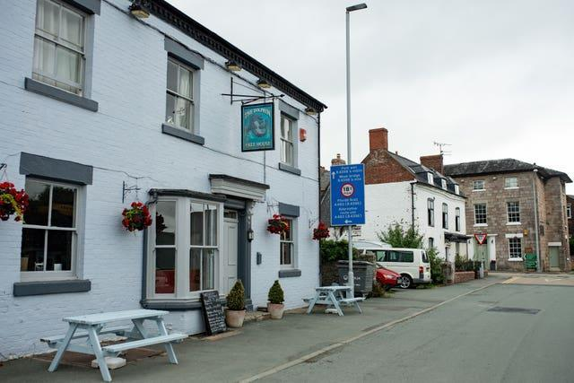 The Dolphin, in Wales, (L) and the Cross Keys, in England, (R) (Jacob King/PA)
