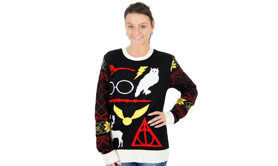 """<p>You don't need to be a Ravenclaw to figure out the Potter symbols on this Deathly Hallows Christmas top. <strong><a rel=""""nofollow noopener"""" href=""""https://www.tvstoreonline.com/shop-by-type/harry-potter-owl-deathly-hallows-sign-ugly-christmas-sweater/?gclid=CjwKEAiAkb-zBRC2upezwuyguQ4SJADZG08vX-l_YmNLNe-xaLRMakBmhaA-gO1Zlg3dbLfavXMKxBoCpB3w_wcB"""" target=""""_blank"""" data-ylk=""""slk:Buy here"""" class=""""link rapid-noclick-resp"""">Buy here</a></strong> </p>"""