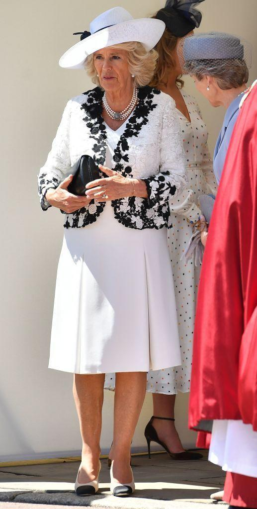 """<p>The Duchess of Cornwall stepped out in a white dress and white jacket embroidered with black floral detail while attending the <a href=""""https://www.townandcountrymag.com/society/tradition/g21599124/queen-elizabeth-prince-william-order-of-the-garter-2018-photos/"""" rel=""""nofollow noopener"""" target=""""_blank"""" data-ylk=""""slk:Order Of The Garter Service"""" class=""""link rapid-noclick-resp"""">Order Of The Garter Service</a> at Windsor Castle.</p>"""