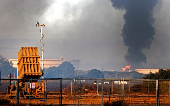 An Iron Dome aerial defence system near Ashkelon's refinery, which was hit by Hamas rockets on Tuesday - AFP