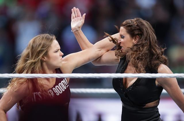 WWE Hall of Famer Jim Ross thinks Ronda Rousey could thrive in professional wrestling. (AP Images)