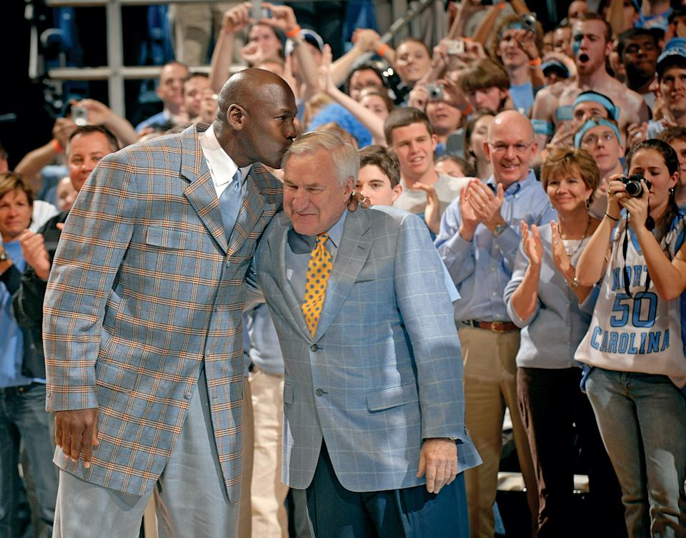 CHAPEL HILL, NC - MARCH 7:  Michael Jordan kisses former coach Dean Smith of the North Carolina Tar Heels during a halftime ceremony honoring the 1993 national championship team during a game against the Wake Forest Demon Deacons at the Dean Smith Center on March 7, 2007 in Chapel Hill, North Carolina.  (Photo by Grant Halverson/Getty Images)