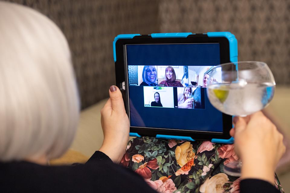 A group of women use the Zoom video conferencing application to have a group chat from their separate homes, during the UK coronavirus lockdown.