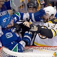 The alleged biting incident occurred when Alex Burrows (L) and Patrice Bergeron mixed it up