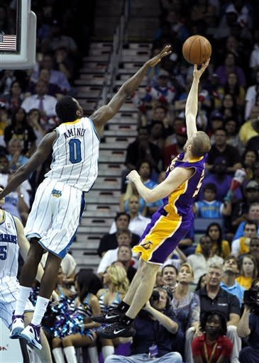 Los Angeles Lakers guard Steve Blake (5) shoots over New Orleans Hornets forward Al-Farouq Aminu (0) in the second half of an NBA basketball game in New Orleans, Monday, April 9, 2012. The Lakers won 93-91. (AP Photo/Gerald Herbert)