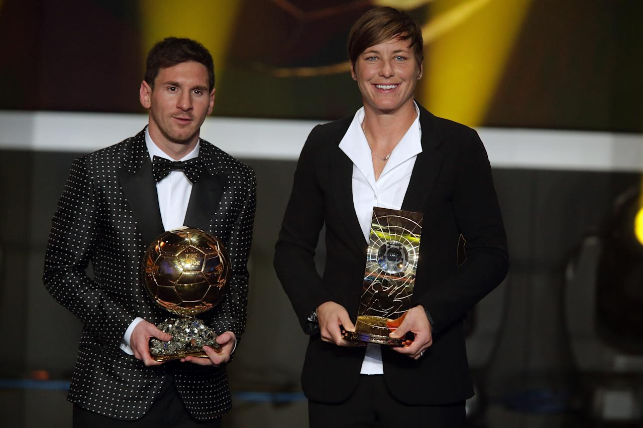 ZURICH, SWITZERLAND - JANUARY 07: Lionel Messi of Argentina receives the FIFA Ballon d'Or 2012 trophy and Abby Wambach of United States receives her FIFA womens player of the year trophy  during the FIFA Ballon d'Or Gala 2013 at Congress House on January 07, 2013 in Zurich, Switzerland. (Photo by Christof Koepsel/Getty Images)