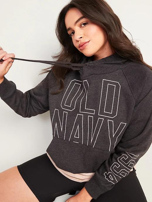 Model wears Logo-Graphic Pullover Hoodie in charcoal. Image via Old Navy.