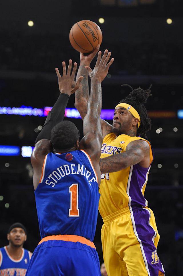 Los Angeles Lakers forward Jordan Hill, right, puts up a shot as New York Knicks forward Amar'e Stoudemire defends during the first half of an NBA basketball game, Tuesday, March 25, 2014, in Los Angeles. (AP Photo/Mark J. Terrill)