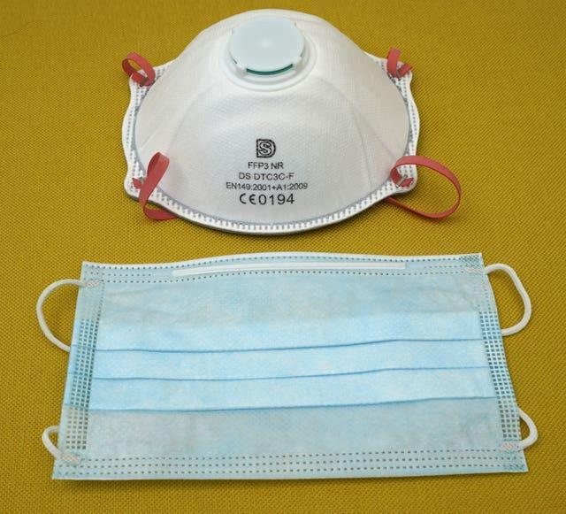 A filtering face piece 3 (FFP3) respirator (top) and a fluid resistant surgical mask