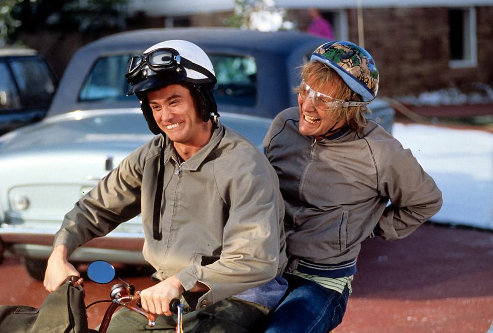 Jim Carrey and Jeff Daniels riding bike in a scene from the film 'Dumb & Dumber', 1994. (Photo by New Line Cinema/Getty Images)