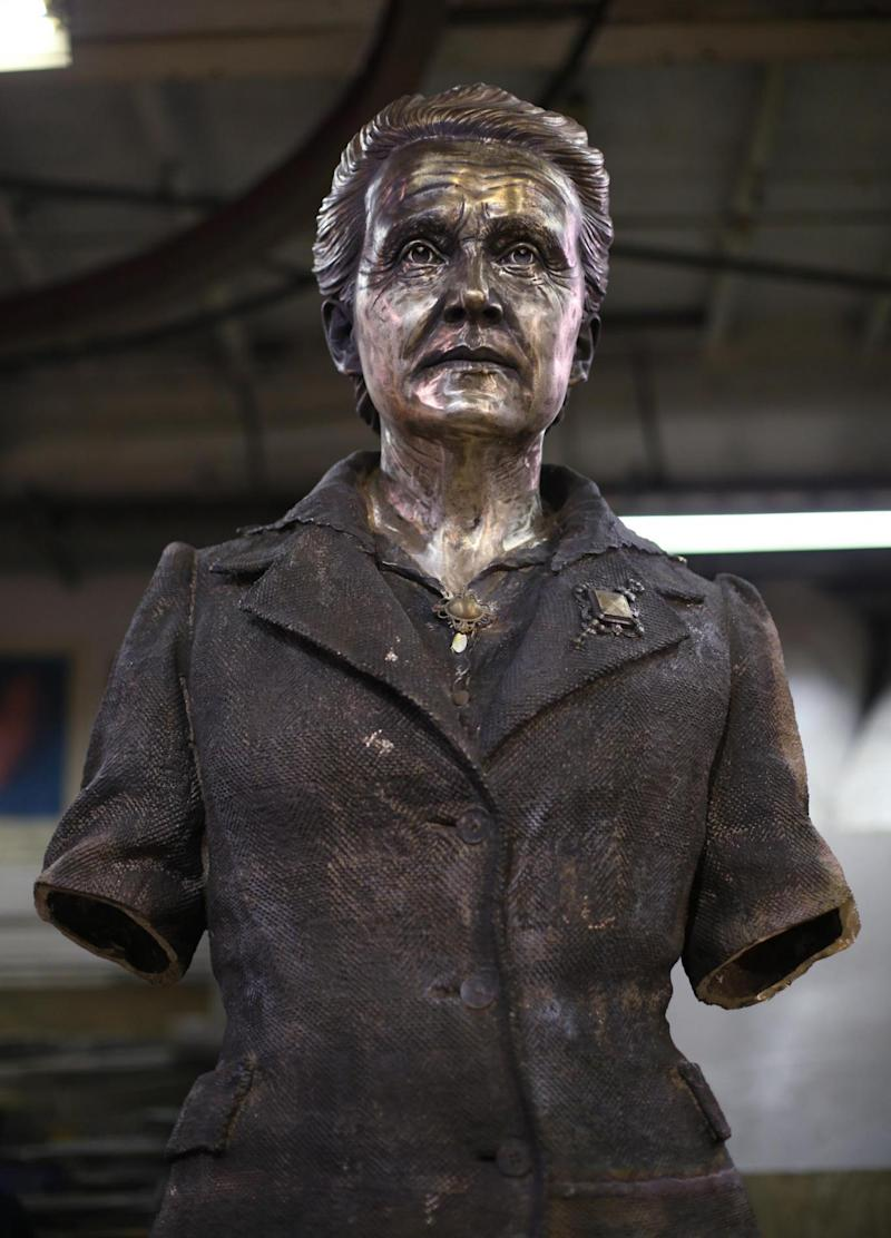 The finishing touches to a statue of suffragist leader Millicent Fawcett at AB Fine Art Foundry, east London (PA)
