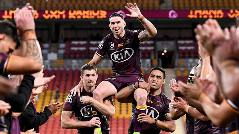 Seen here, Darius Boyd is carried off the ground after his NRL swan song.