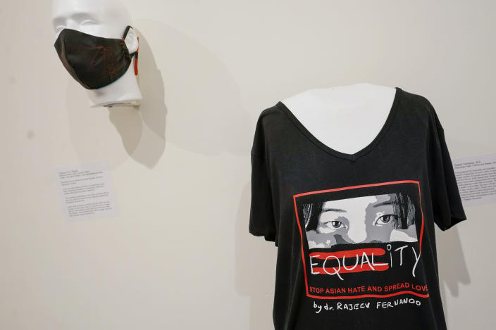 """""""Stop Asian Hate"""" T-shirt and mask by Rajeev Fernando are on display during the press preview of """"Responses: Asian American Voices Resisting the Tides of Racism"""" at the Museum of Chinese in America, Wednesday, July 14, 2021, in New York. (AP Photo/Mary Altaffer)"""