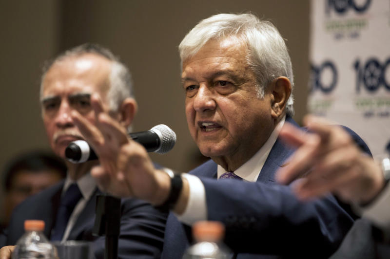 Mexico's President-elect Andres Manuel Lopez Obrador gives a press conference in Mexico City, Monday, July 9, 2018. Lopez Obrador campaigned on a promise to return to Mexico's traditional foreign policy of nonintervention. (AP Photo/Moises Castillo)