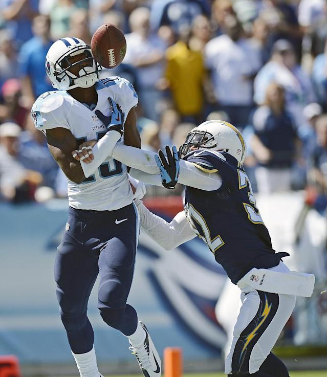 Tennessee Titans wide receiver Justin Hunter (15) can't hang onto a pass as he is defended by San Diego Chargers free safety Eric Weddle (32) in the second quarter of an NFL football game on Sunday, Sept. 22, 2013, in Nashville, Tenn. (AP Photo/Mark Zaleski)