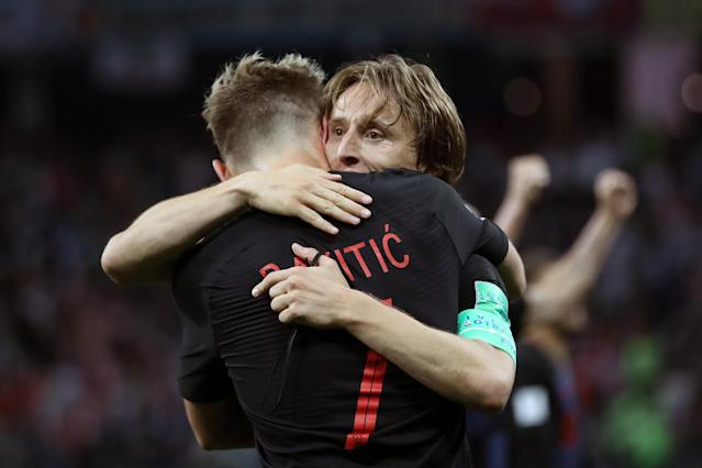 Ivan Rakitic of Croatia celebrates with teammate Luka Modric of Croatia after scoring his team's third goal during the 2018 FIFA World Cup Russia group D match between Argentina and Croatia at Nizhny Novgorod Stadium on June 21, 2018 in Nizhny Novgorod, Russia. (Getty Images)