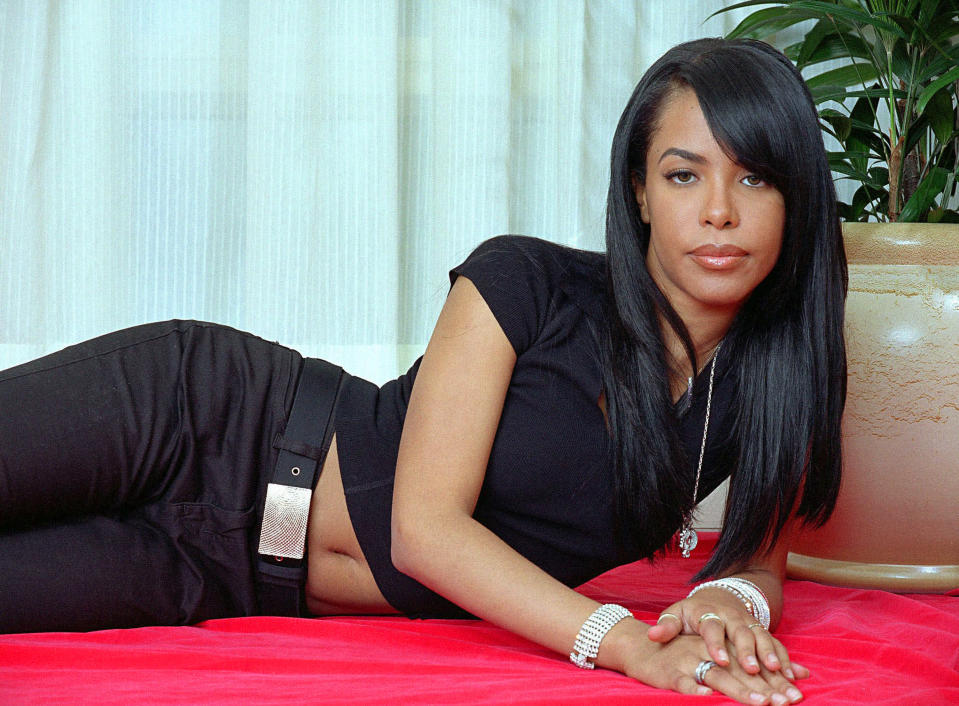 """FILE - R&B singer and actress Aaliyah poses for a photo in New York on May 9, 2001. The song """"Miss You,"""" written by Johnta Austin with Ginuwine, was released in 2002 following Aaliyah's tragic death a year prior, and the music video was a tribute to her life and legacy, with everyone from Jay-Z to Missy Elliott making cameos. (AP Photo/Jim Cooper, File)"""