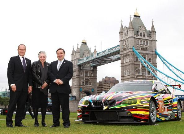 LONDON, ENGLAND - JULY 3: (L-R) Graham Biggs, BMW Group UK Corporate Communications Director, Ruth Mackenzie, Director London 2012 Festival and Gregor Muir, Executive Director ICA pose with the transformed M3 GT2 during the launch of BMW Art Car at Potters Field on July 3, 2012 in London, England. (Photo by Jan Kruger/Getty Images for BMW)