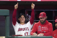 Los Angeles Angels designated hitter Shohei Ohtani, left, gestures from the dugout toward Jack Mayfield after Mayfield hit an RBI single during the seventh inning of a baseball game against the Seattle Mariners Friday, Sept. 24, 2021, in Anaheim, Calif. (AP Photo/Mark J. Terrill)