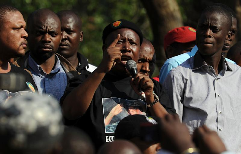 African National Congress Youth League  (ANCYL) president Julius Malema,  center, addresses supporters after appearing at ANC headquarters in downtown Johannesburg, Tuesday, Aug. 30, 2011 at the start of a disciplinary hearing against him. Malema could be expelled or suspended from the ANC for bringing the party into disrepute with their calls for the overthrow of the government of neighboring Botswana. (AP Photo/Chris Collingridge-Star) SOUTH AFRICA OUT