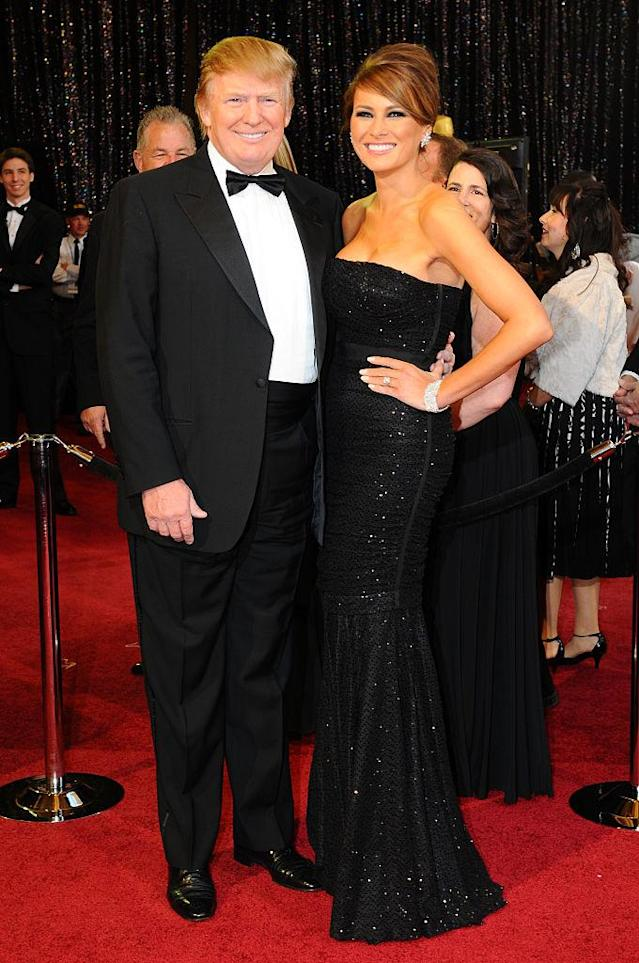 <p>In 2011, Melania wore a simple black strapless gown and a chic side-parted updo to the 83rd Academy Awards. (Photo: Getty Images) </p>