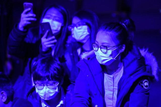 Badminton fans wore facemasks at the All England Championships in Birmingham (AFP Photo/Oli SCARFF )