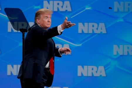 FILE PHOTO: President Trump tosses a pen after signing an executive order at the annual NRA meeting in Indianapolis