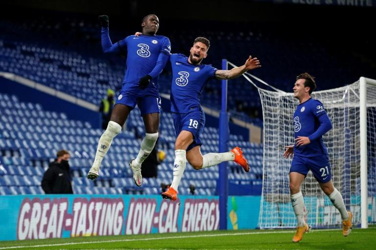 Flying high: Kurt Zouma (left)scored the winner as Chelsea went top of the Premier League