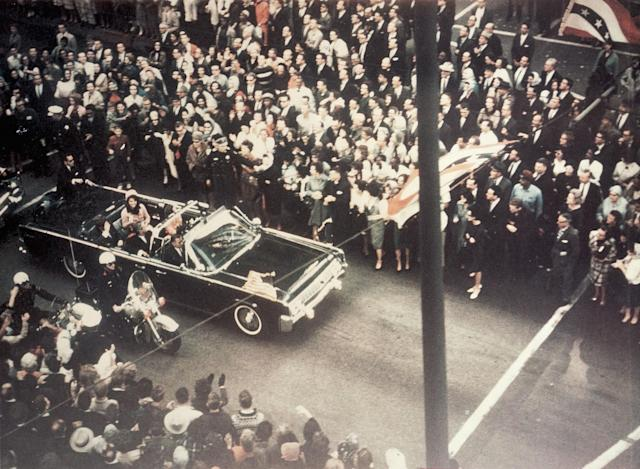 <p>President John F. Kennedy, First Lady Jacqueline Kennedy, and Texas Governor John Connally ride through the streets of Dallas, Texas prior to the assassination on Nov. 22, 1963. Included as an exhibit for the Warren Commission. (Photo: Corbis via Getty Images) </p>