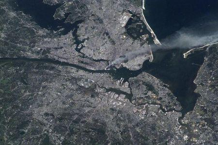 A smoke plume rises from lower Manhattan September 11, 2001 in this photo taken from space on the International Space Station (ISS) and released by NASA on September 11, 2011. REUTERS/ISS Expedition 3 Commander Frank L. Culbertson/NASA