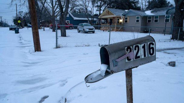 PHOTO: A mailbox is seen frozen in a snow covered neighborhood in Waco, Texas as severe winter weather conditions over the last few days has forced road closures and power outages over the state, Feb. 17, 2021. (Matthew Busch/AFP via Getty Images, FILE)