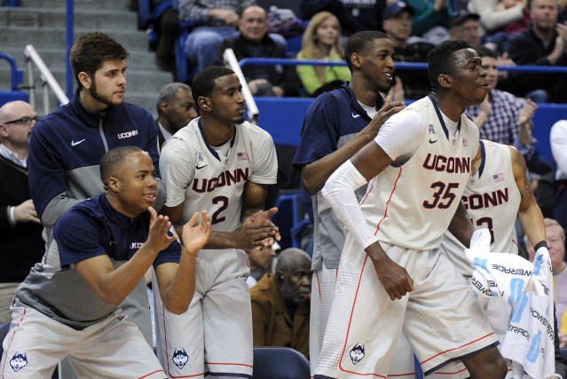 Connecticut players react during the second half of their team's 51-45 victory over Cincinnati in an NCAA college basketball game in Hartford, Conn., Sunday, March 1, 2014. (AP Photo/Fred Beckham)