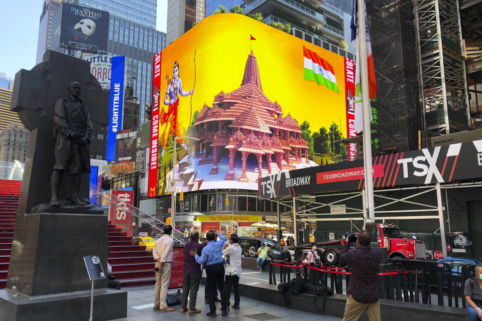 Imagery of the Hindu deity Ram and 3-D portraits of the proposed Hindu temple are displayed on a digital billboard in Times Square, Wednesday, Aug. 5, 2020, to celebrate the groundbreaking ceremony of a temple dedicated to the Hindu god Ram by Indian Prime Minister Narendra Modi in Ayodhya, in New Delhi, India. Hindus rejoiced as Modi broke ground on a long-awaited temple of their most revered god, Ram, at the site of a demolished 16th century mosque. (AP Photo/Ted Shaffrey)