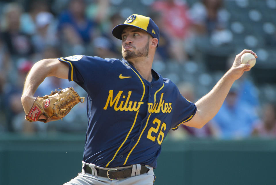 Milwaukee Brewers relief pitcher Aaron Ashby delivers the final pitch, striking out Cleveland Indians' Franmil Reyes, during the ninth inning of a baseball game in Cleveland, Sunday, Sept. 12, 2021. (AP Photo/Phil Long)