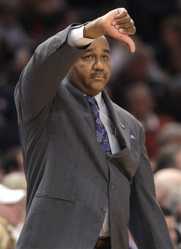 Georgetown head coach John Thompson III gestures during the quarterfinals round of the Big East NCAA college basketball conference tournament in New York, Thursday, March 8, 2012. Cincinnati defeated Georgetown in double overtime 72-70. (AP Photo/Seth Wenig)